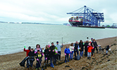 Staff and families of Port of Felixstowe clean up a stretch of beach adjacent to the terminal.