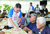 PARKnSHOP Hong Kong's volunteer team serves meals to the elders at charity partner Food Angel's Community Centre.